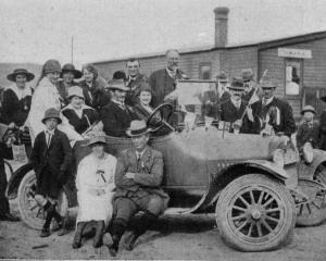 "Armistice Day celebrations at Owaka: A car in the procession containing the ""Mayor'' and local..."