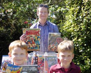 Comic book diehard Liam Hartnett (centre) and his two sons Aodhan (5) and Finn (9) showcase their...