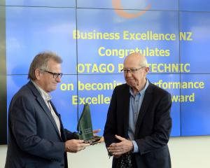 Otago Polytechnic chief executive Phil Ker (left) receives the performance excellence award from...