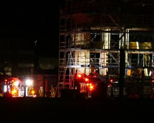 Firefighters respond to a fire at a construction site on Hawthorne Drive, in Frankton, last night...