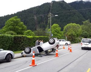 A car ended up on its roof after rolling near the Queenstown CBD this morning. Photo: Tracey...