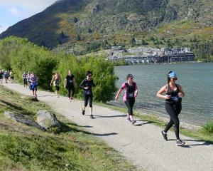 Runners make their way past Frankton Beach during today's Queenstown International Marathon....
