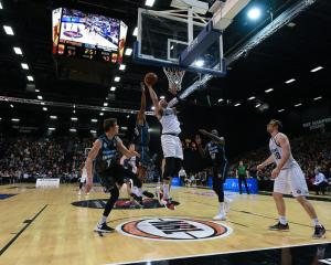 Melbourne United big man Josh Boone heads for the basket in the 108-101 Australian National...