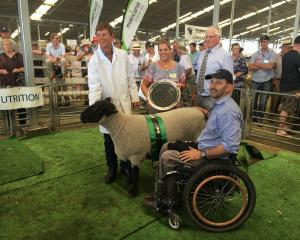 Charles Miller-Brown (left), of Amberley, was surprised to win supreme champion meat sheep and is...