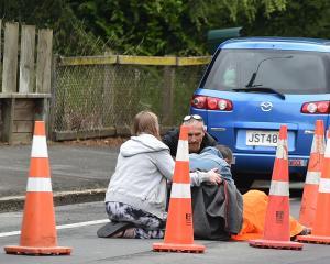 A road rage victim is treated in Wakari. Photo: Tim Miller