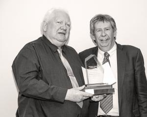 The Unsung Hero Award was presented to Bill Little by Deputy Commissioner Richard Thomson