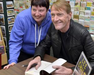 Dunedin Lee Child fan Lauren Batten gets a book signed by her favourite author. Photo: Gerard O...