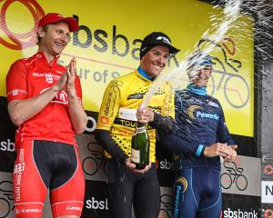 Tour of Southland champion Michael Vink (centre) celebrates with runner-up Hamish Bond (left) and...