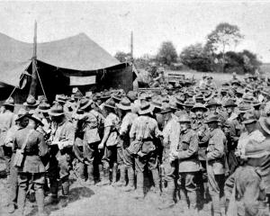 New Zealand troops queueing to place bets at the totalisator run on the gymkhana sports at a New...