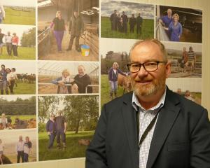 Mataura Valley Milk chief executive Bernard May with photos of farmers/shareholders in the...