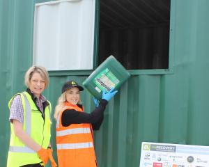 Placing a container into the recycling station at Farmlands Taieri is Agrecovery operations...