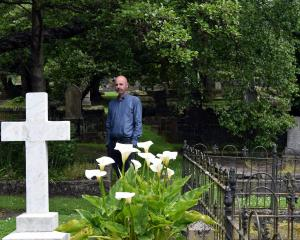 Dunedin Budget Advisory Service executive officer Andrew Henderson inspects graves in the...