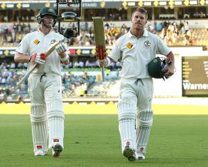 Steve Smith (left) and David Warner leave the field for Australia prior to receiving their bans....