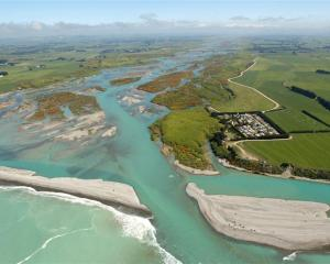The Waitaki River leaves the plains and enters the Pacific Ocean near Glenavy, photographed in...