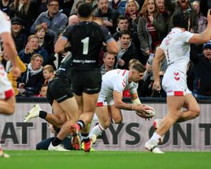 England's Tommy Makinson scores against the Kiwis in the second half at Anfield. Photo: Getty Images
