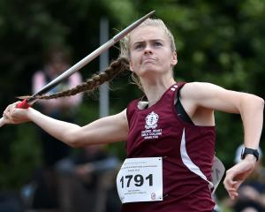 Kayla Goodwin, of Sacred Heart Girls' College, throws the javelin yesterday. Photo: Peter McIntosh
