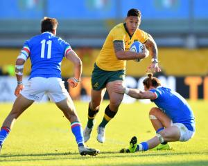 Israel Folau of Australia takes on Mattia Bellini (left) and Tommaso Benvenuti of Italy during...