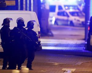 French special police forces secure an area during a police operation where the suspected gunman,...