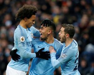 Manchester City's Gabriel Jesus (C) celebrates with Leroy Sane (L) and Bernardo Silva after...
