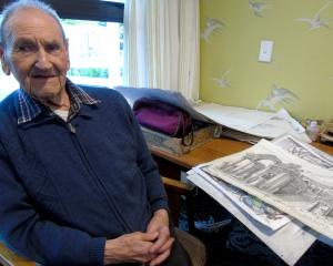 Working on his drawings is Reg Deason, of Wanaka, who celebrated his centenary at Elmslie House...