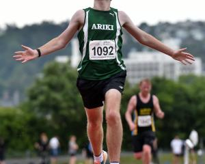 Aaron Anderson wins the Otago 10,000m championships at the Caledonian Ground on Saturday. Photo:...