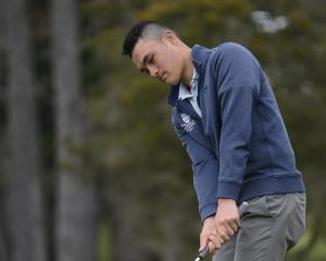 Golfer Parker Aluesi practises at St Clair Golf Club yesterday. Photo: Gerard O'Brien