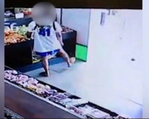 The thief was captured on CCTV entering the store and drop-kicking the fruit outside the door....