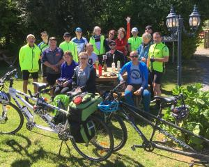 Participants in the Blind Foundation's national tandem bike event take a break after reaching...
