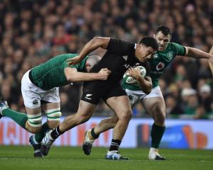 Codie Taylor on the run for the All Blacks against Ireland this season. Photo: Getty Images