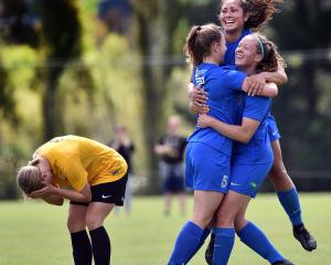 Southern United players Lena de Ronde, Shontelle Smith and Renee Bacon celebrate, while Capital's...