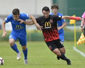 Southern United's Abdulla Al-Kalisy on the attack as Canterbury United's Sean Liddicoat aims to...
