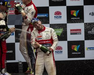 Mads Ostberg celebrates his podium finish at the FIA World Rally Championship of Australia last...