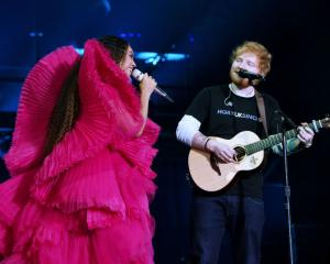 Beyonce and Ed Sheeran perform during the Global Citizen Festival: Mandela 100 at FNB Stadium in...