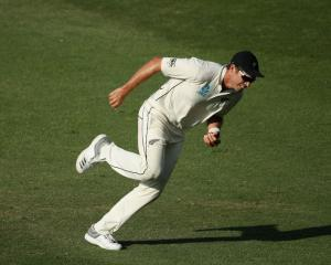 New Zealand's Tim Southee celebrates after taking a catch in the third test against Pakistan in...