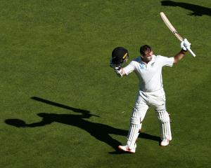 Tom Latham  leaves the field at the end of his marathon 264 not out during day three of the first...