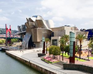 The Guggenheim Museum in Bilbao, Spain attracts worldwide attention, draws tourists and has...