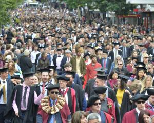 University of Otago graduands walk along George St, Dunedin, in a graduation parade before yesterday's two graduation ceremonies at the Dunedin Town Hall. Photo: Gerard O'Brien