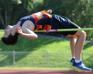 John McGlashan College's Nathan Harrison (16) competes in the under-16 high jump at the Otago...