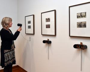 Hocken photography curator Dr Anna Petersen looks through a new hand-crafted stereoscope the...