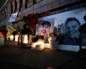 Flowers and candles in memory of Louisa Vesterager Jespersen and Maren Ueland are seen at the...