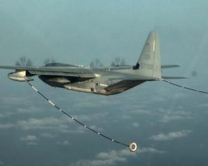 A KC-130 Hercules conducting air refuelling training over the Pacific Ocean. Photo: US Marine...