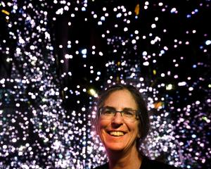 Megan Donahue talks about the mysteries of the universe at Otago Museum yesterday. Photo: Peter...