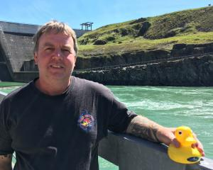 Contact Energy site support manager Clayton Andrews holds the plastic duck retrieved on November...
