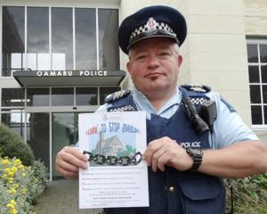 Sergeant Tony Woodbridge, of Oamaru, with the information being delivered to addresses in Oamaru...