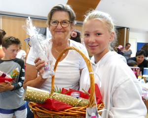 Volunteers Els Kleinjan (left) and Hazel van Asch help to put together festive treats for those...