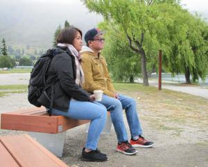 Danielle and Dan Santos, of Melbourne, try out one of the new wooden seats that have replaced the...
