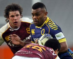 Otago No 8 Naulia Dawai carries the ball as Southland hooker Dillan Halaholo prepares to make a...
