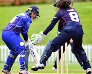 Otago Sparks batsman Katey Martin looks around while Auckland wicketkeeper Tariel Lamb tries to...