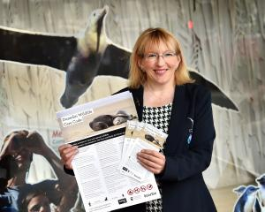 Dunedin Host Sustainability Group chairwoman Sophie Barker shows off the new Dunedin Wildlife...