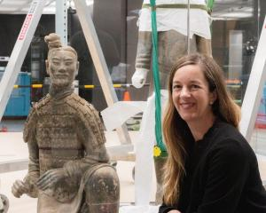 Te Papa curator Dr Rebecca Rice takes a look at one of the terracotta warriors being installed in...